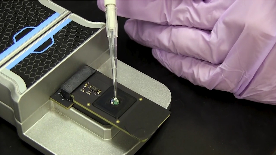Screencapture from video showing the graphene chip being loaded