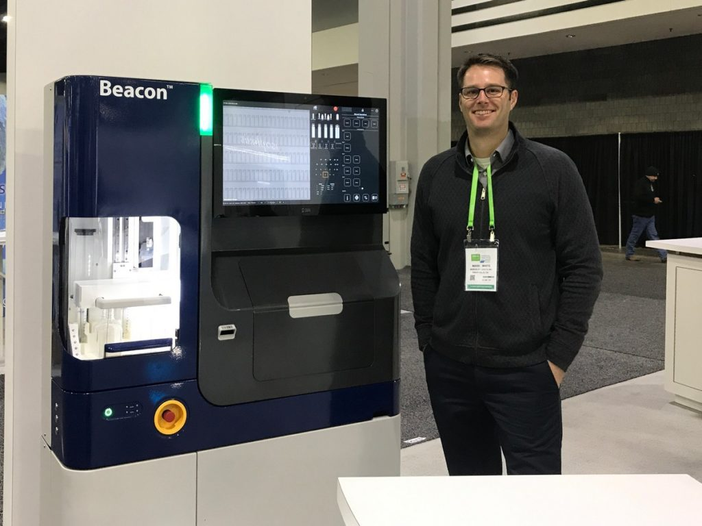 Dr. Mark White (Dir of Scientific Affairs, Berkeley Lights) in front of the Beacon at #AACR19