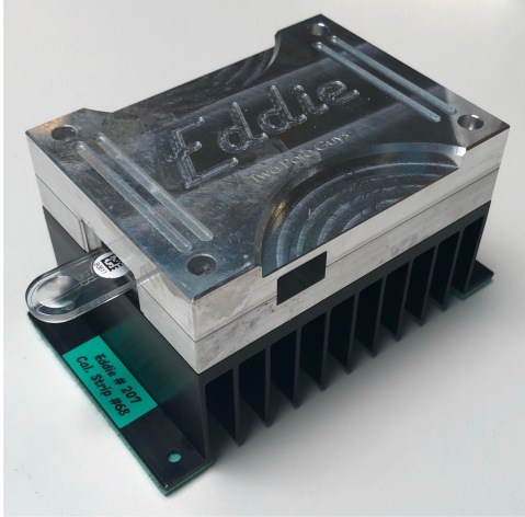 """The 2PG nanopore reader device, labled 'Eddie' measuring 4"""" x 3"""" x 2.5"""" and weighs 1.3 lb"""