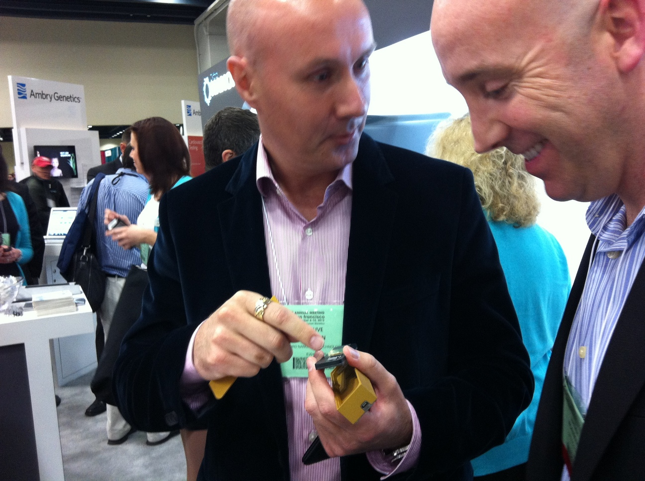 Clive Brown (left) showing the minION at their ASHG 2012 booth. Matthew Hickenbotham, colleague at Life Technologies, at right.